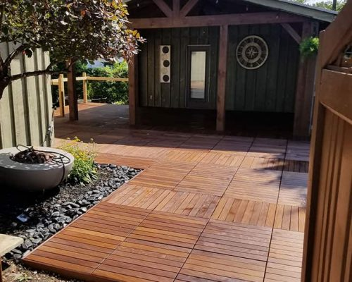 2-by2ft-Ipe-structural-tile-install-over-a-backyard-with-black-river-rocks,-and-perimeter-Ipe-boards-raised-ipe-deck-5-finished-final-shot