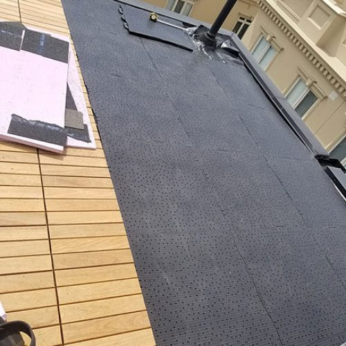 Underlay-for-the-turf-roll-being-laid-down-progress-shot